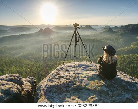 Woman Hiker With Leather Hat Conquer Highest Peak. Woman Hiker Traveling Alone In Nature. Mountain L