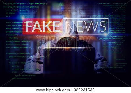 Hacker Working On A Computer Laptop, Double Exposure With Screen Of Fake News. Manipulated Content O