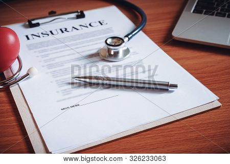 Close-up Of Insurance Policy Contract Papers. Life Insurance Policy Terms Of Use Concept.