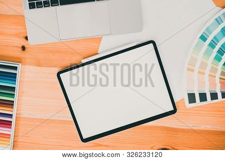 Overhead Shot Of Comfortable Graphic Design Workplace With Blank Screen Mockup Tablet On Desk Backgr