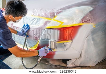 Repairing Car Body By Puttying Close Up Work After The Accident By Working Sanding Primer Before Pai