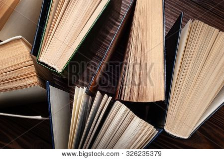 Old Books . Close-up Stack Of Old Open Books On A Dark Background. Books Textbooks For Reading And E