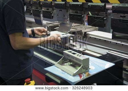 Operation Of Hydraulic Bending Machine With Forming Die By Skill Operator. The Sheet Metal Manufactu
