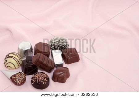 Luxury Chocolates On A Pink Background