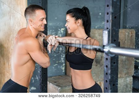 Loving Couple In Gym Talking After Workout. Close Up Photo.