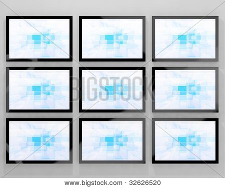 TV Monitors Wall Mounted Representing High Definition Television