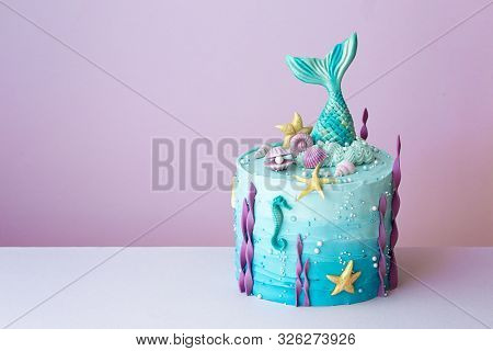 Mermaid birthday cake on a purple background
