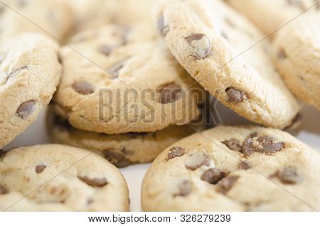 Lots Of Chocolate Chip Cookies. Close-up On Baking. Delicious Homemade Dessert.