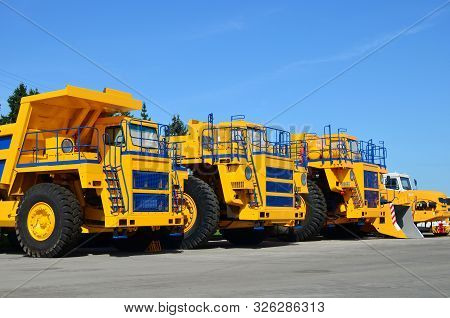 Heavy-duty Trucks Warehouse At Autoworks. Giant Mining Dump Trucks Manufacture By The Heavy Vehicle