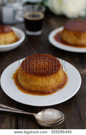 Caramel Flan, Crema Catalana Dessert On Dark Brown Woden Table