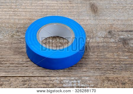 Blue Sticky Tape. Blue Insulating Tape. Duct Tape. Construction Tool On A Wooden Background. Close U