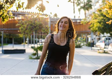 Stock Photo Of A Woman In A Park, She Is Smiling. People, Lifestyle