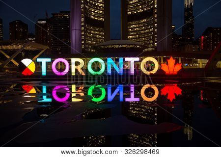 TORONTO CANADA MAY 6, 2017:Colourful Toronto sign at Nathan Phillips square during the evening in Toronto, Canada. The Square is used regularly for art exhibits, concerts, rallies and other ceremonies