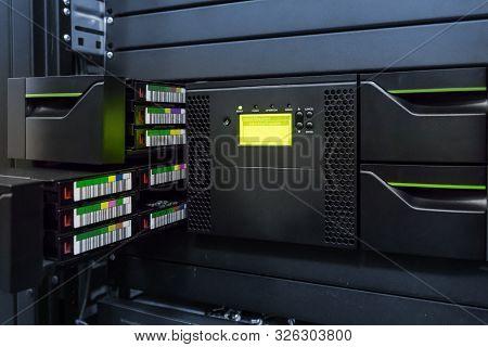 Streamer, Tape Library For Data Backup In The Server Rack In The Datacenter.