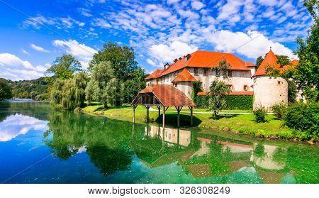 Wonderful romantic castle on the island medieval Grad Otocec in Krka river. Slovenia