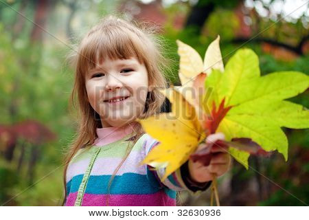 Smiling Girl With Fallen Leaves
