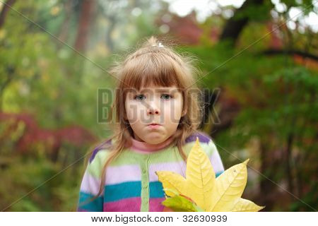 Girl With Fallen Leaves