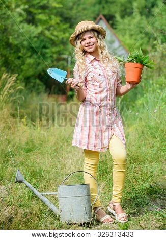 Ranch Girl. Happy Childhood. Planting Plants. Little Kid Hold Flower Pot. Spring Country Works. Happ
