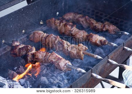 Skewers On Skewers.roasted Meat Cooked At Barbecue.bbq Fresh Beef Meat Chop Slices. Traditional East