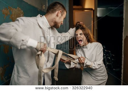 Psychiatrist and female patient in a fit of rage