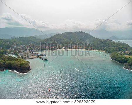Aerial Shot Of The Town Of Padang Bai With Marine Port. Bali, Indonesia