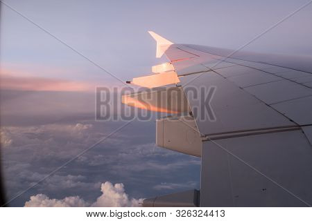 Flying In The Air With This Giant Wing Of A380-800 Plane On A Sunset On The Way To Further North