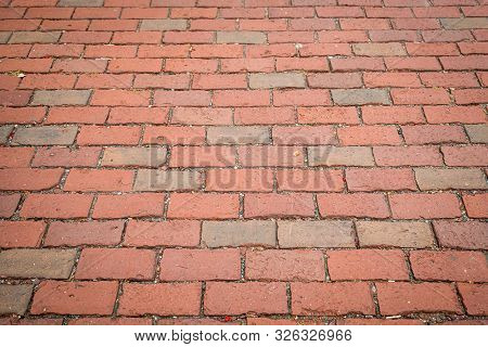 Textured Red Brick Sidewalk Background With Receding Perspective