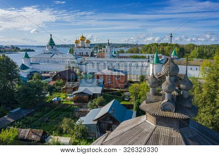 Aerial view of old wooden church and Ipatievsky (Hypatian) Monastery in ancient touristic town Kostroma, Russia.