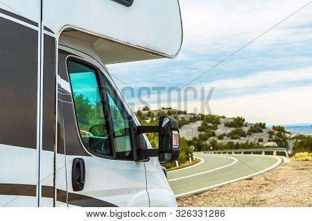 Modern Camper Van Rv Road Trip. Motorhome On The Scenic Vista Stop. Travel Industry.