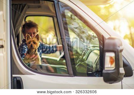 Caucasian Retired Woman Traveling With Dog In The Motorhome Rv Camper Van. Australian Silky Terrier
