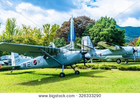 Daejeon, South Korea; October 3, 2019: Cessna 140 Military Trainer In Front Nike Hercules Missile An