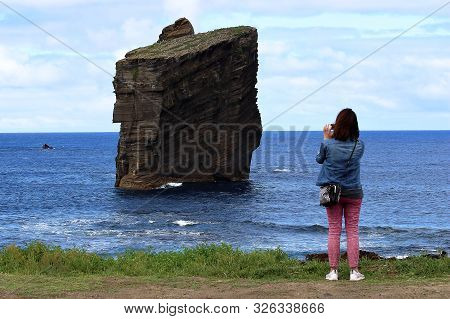 San Miguel, Portugal - September 15, 2019: A Tourist Taking Picture Of The Iconic Wild Rock Formatio