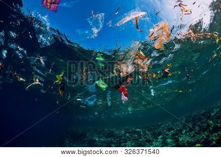 August 28, 2018. Bali, Indonesia. Underwater Ocean With Plastic And Plastic Bags, Ecological Problem