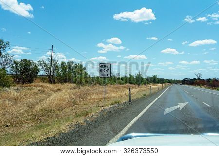 Merge right arrow sign on an Australian country highway poster