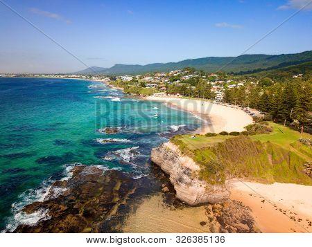 Beautiful Coastal Beach Scene With Sandy Beaches Backed By Rising Escarpment Cliffs.  Location:  Aus
