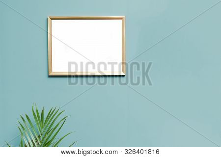 Modern Home Interior Wall With Empty Blank Picture Frame To Display Photo