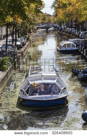 Delft, Netherlands - September 20, 2019: Tour Boat With Skipper In A Canal In Delft In The Netherlan