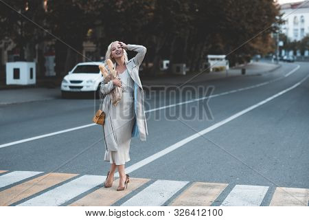 Elegant Woman 20-24 Year Old Wearing Stylish Dress And Autumn Jacket Holding Fresh Bread Standing In