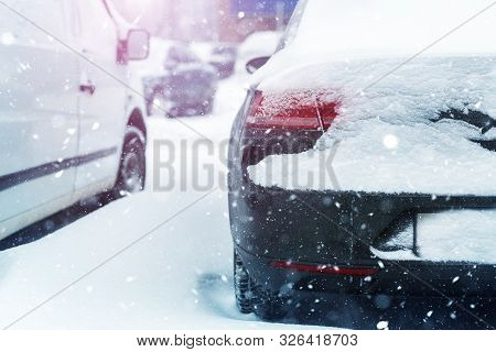 Car Parked On City Street Covered With Thick Snow Layer During Snowstorm Blizzard At Winter. Vehicle