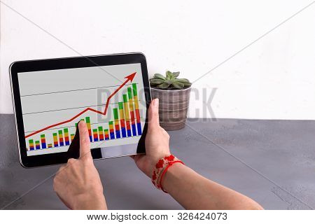 Office Workplace With Comouter And Business Charts