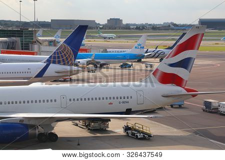 Amsterdam, Netherlands - July 11, 2017: Airlines At Schiphol Airport In Amsterdam. Schiphol Is The 1