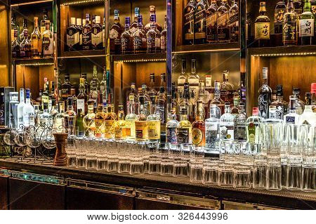 24.02.2019 Peking China - Wall With Bitters And Alcohols Whiskey Bar Counter Bottles Ambient Tlight