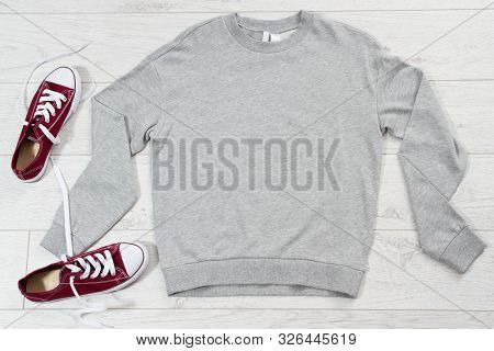 Empty Gray Pullover Mock Up Top View And Red Sneakers