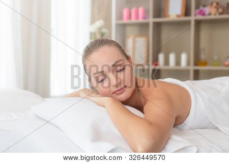 Beautiful Young Woman Relaxing With Hand Massage At Beauty Spa. Body Massage. Closed Up Of Young Bea