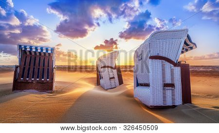 Sunset At The Baltic Sea With Beach Chairs