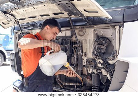 Mechanic Changes Engine Oil And Diesel Truck Filter