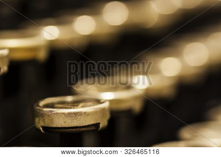 Sepia-toned, Extreme Close Up Of Rows Of Mechanical Typewriter Keys. Viewed From A Shallow Angle, Th