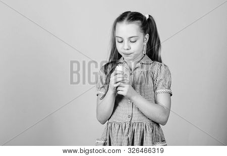 More Flavor More Fun. Small Child Licking Ice Cream With Natural Flavor. Cute Little Girl Enjoy Flav