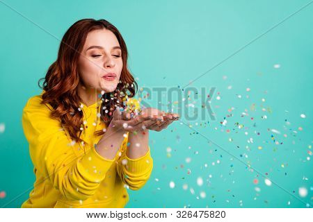 Photo Of Curly Wavy Trendy White Cheerful Charming Sweet Pretty Youngster Blowing Confetti Away From