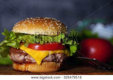 Homemade Hamburger With Fresh Vegetables. Tasty Grilled Burger With With Beef, Cheese, Vegetables. D